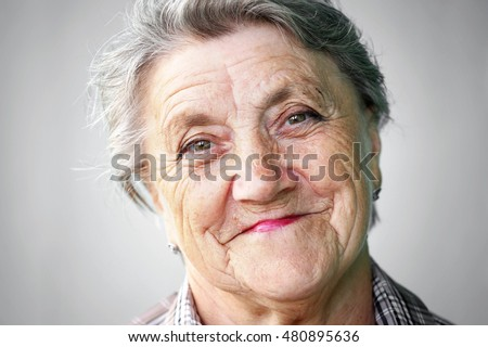 Smile granny face on gray background. Grandmother