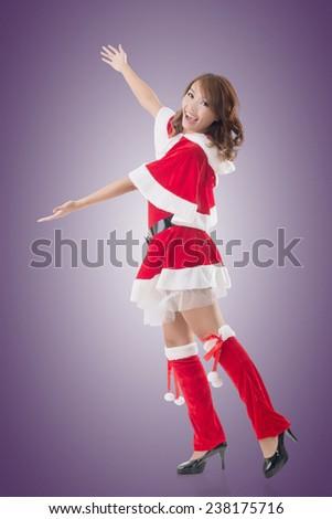 Smile happy Asian Christmas girl introduce, isolated full length portrait. - stock photo