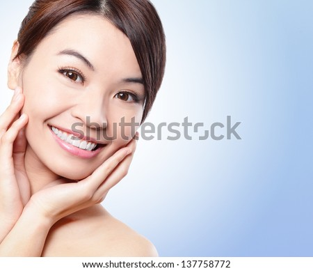 Smile happy Face of beautiful woman with health teeth and skin isolated on blue background. Beautiful young asian woman model - stock photo