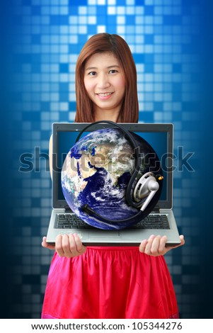 Smile lady and Communications world on notebook computer : Elements of this image furnished by NASA - stock photo