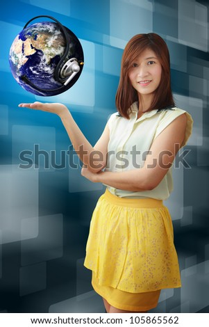 Smile lady hold the digital world : Elements of this image furnished by NASA - stock photo