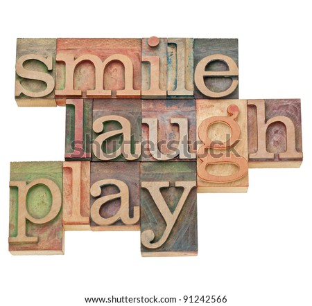 smile, laugh, play  - isolated word abstract in vintage wood letterpress printing blocks - stock photo