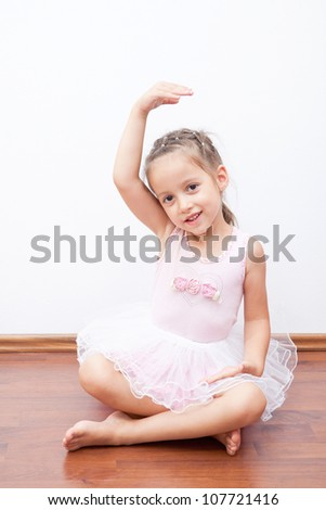 smile little ballerina have exercises - stock photo