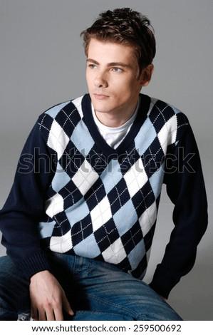 Smile man in fashion-gray background - stock photo