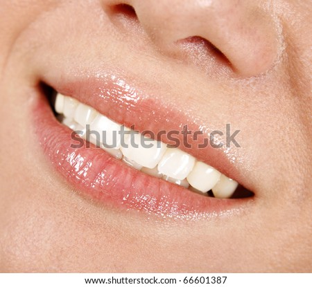 Smile of a beautiful woman - stock photo