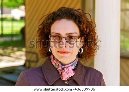 Smile of a beautiful woman in glasses. - stock photo