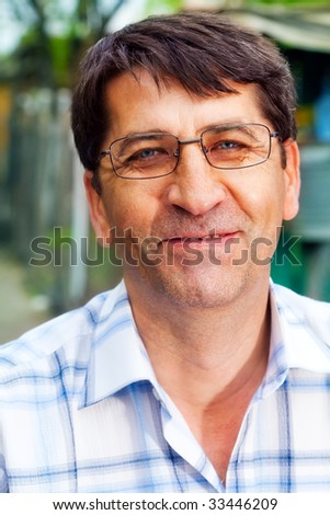 Smile of one mature happy business man outdoor - stock photo