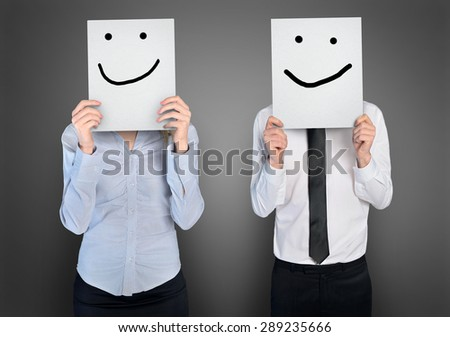Smile shape on paper in hands of business woman and man
