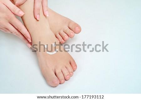 Smile shape on woman feet - stock photo