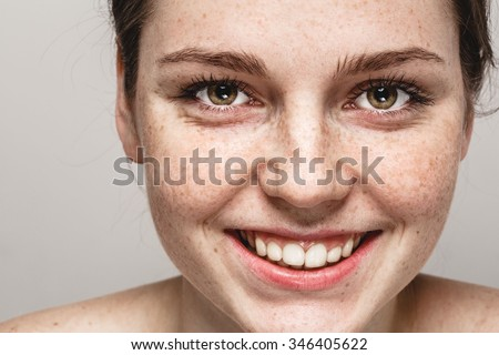 Smile teeth Young beautiful freckles woman face portrait with healthy skin - stock photo
