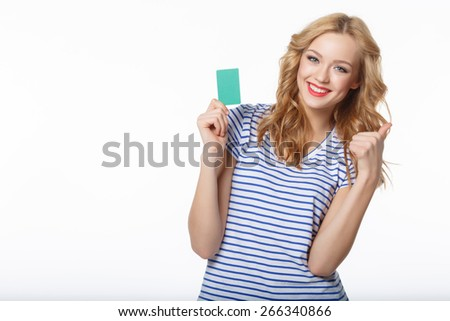 Smile the young woman showing the card of the blank credit, on a white background - stock photo