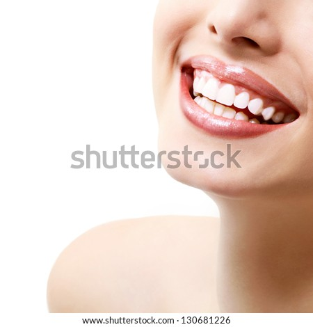 Smile. Young beautiful woman with perfect smile over white background - stock photo