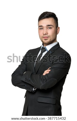 Smile young man in business suit, arms crossed his chest, isolated on a white background - stock photo