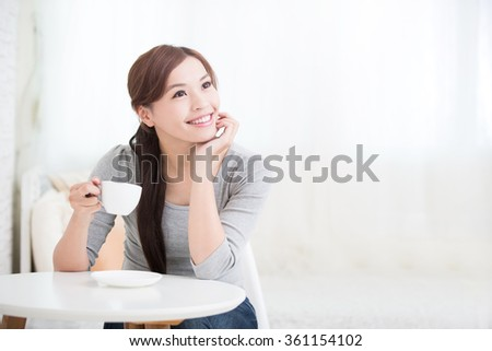 smile young woman holding cup of coffee or tea at home, healthy lifestyle concept, asian beauty, asian beauty - stock photo