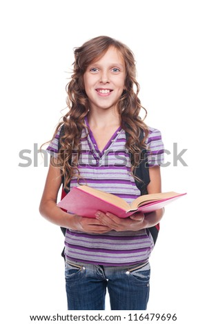 smiley and pretty girl holding the book. studio shot against white background - stock photo