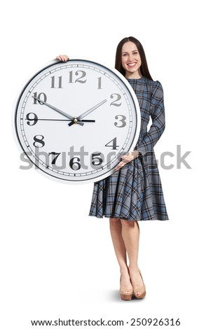 smiley beautiful woman with big clock posing over white background - stock photo