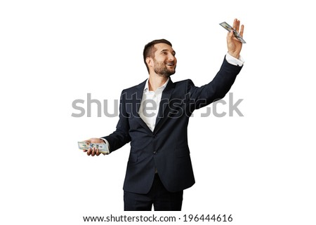 smiley businessman holding paper money over white background - stock photo