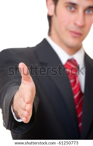 smiley businessman is going to shake your hand - stock photo