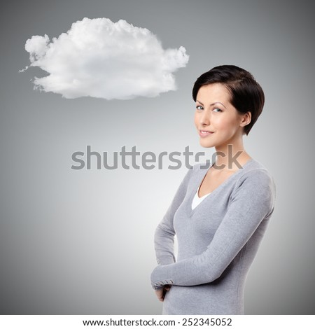 Smiley cheerful woman with cloud, on grey - stock photo