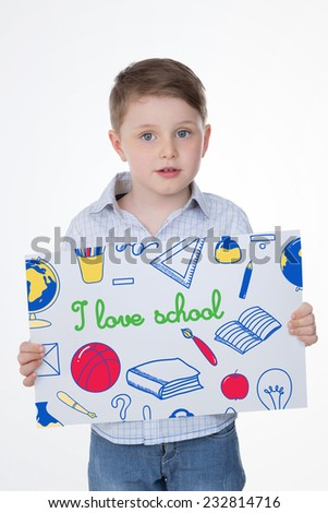 smiley child presents his drawing on rectangular leaf - stock photo