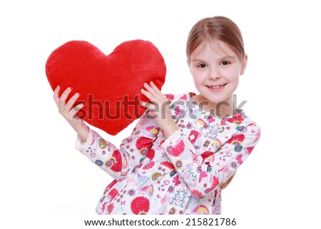 Smiley european little girl holding red heart isolated over white background - stock photo