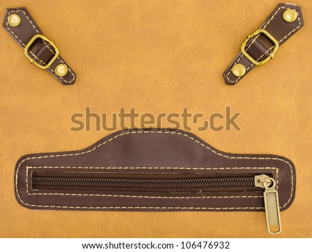 smiley face by a leather bag zipper
