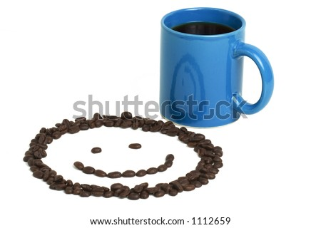 Smiley face made from fresh coffee beans and a blue cup of coffee on a white background.  Smiley face reflected in the cup. - stock photo