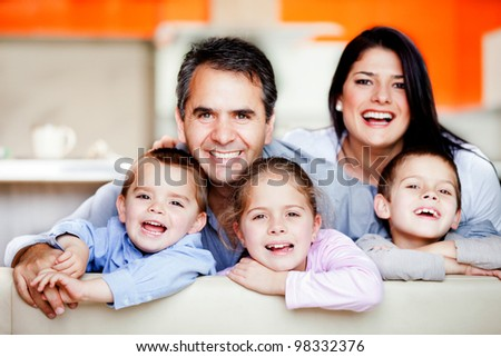 Smiley family portrait having fun at home - stock photo