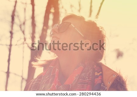 Smiley girl in nature. - stock photo