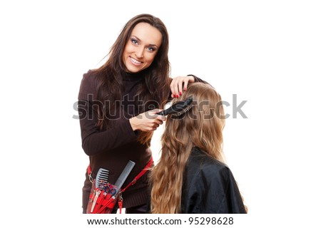 smiley hairdresser doing hairstyle. isolated on white background - stock photo
