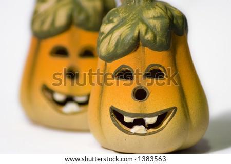 Smiley Jack-O-Lantern Pumpkins on a white background - stock photo
