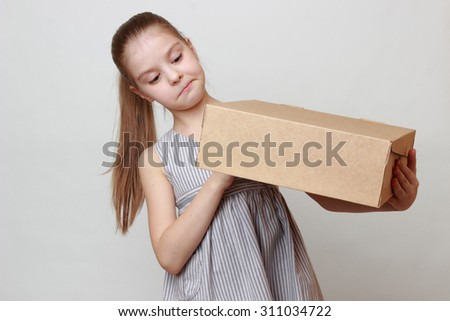 Smiley little girl with empty box