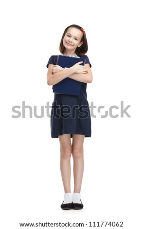 Smiley schoolgirl carries her books, isolated, white background - stock photo