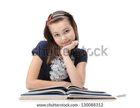 Smiley schoolgirl studies useful material, isolated, white background - stock photo