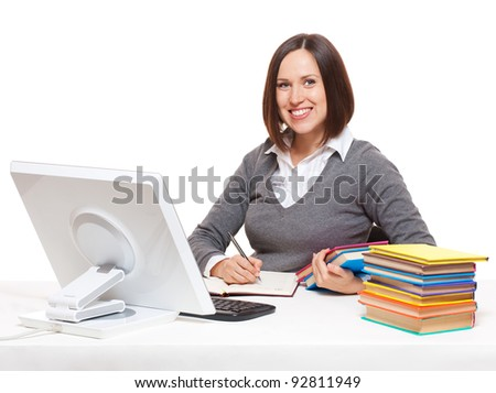 smiley student  with books sitting on her workplace. isolated on white background - stock photo