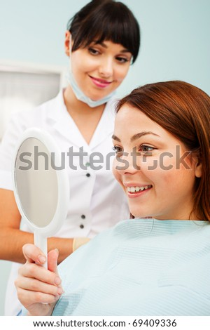 smiley woman looking at her beautiful teeth - stock photo