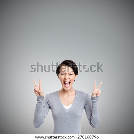 Smiley woman shows peace sign with two hands, isolated on white - stock photo