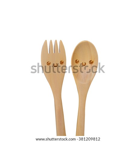 Smiley wooden spoon and fork - stock photo