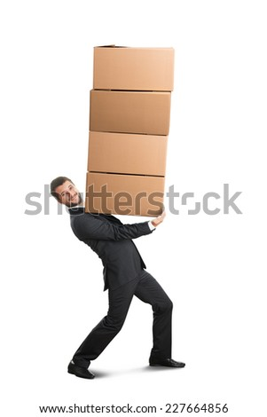 smiley young businessman looking at camera and carrying four heavy boxes on the hands. isolated on white background - stock photo
