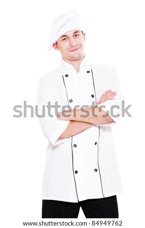 smiley young cook standing over white background