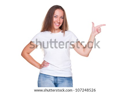 smiley young female pointing at empty copyspace. isolated on white background - stock photo