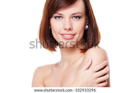 smiley young woman in studio isolated on white background