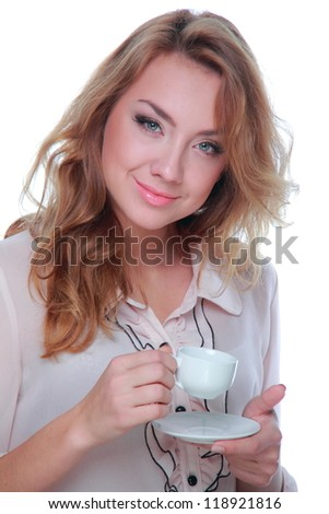 Smiley young woman is holding coffee cup