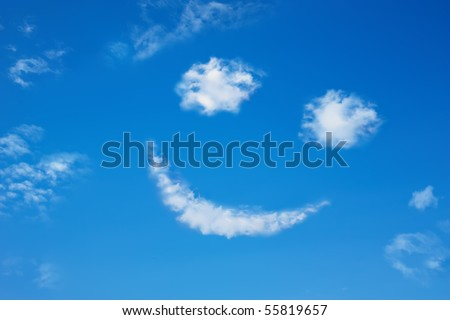 Smilie from cloud in the blue sky - stock photo