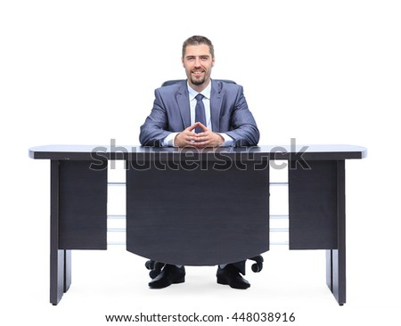 Smilind businessman sitting at table isolated on white background - stock photo