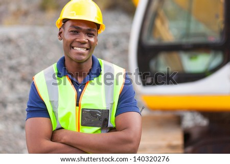 smiling african american industrial worker with arms crossed - stock photo