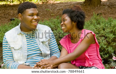 Smiling African American teenage couple - stock photo