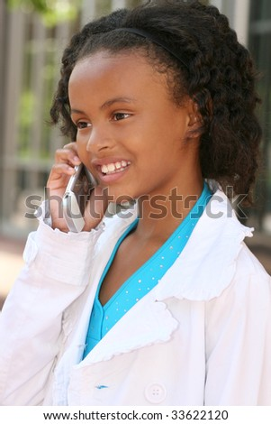 Smiling African American Teenager Girl on Cell Phone, talking - stock photo