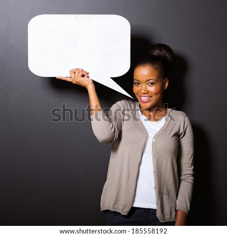 smiling african american woman holding paper speech bubble - stock photo