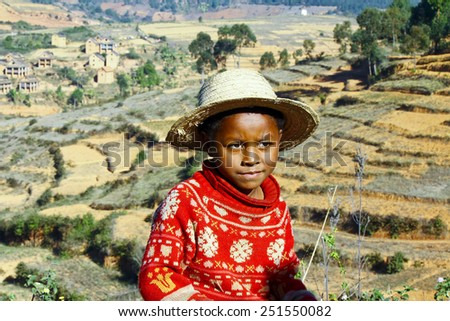 Smiling african boy with hat on head, poverty in Madagascar - stock photo